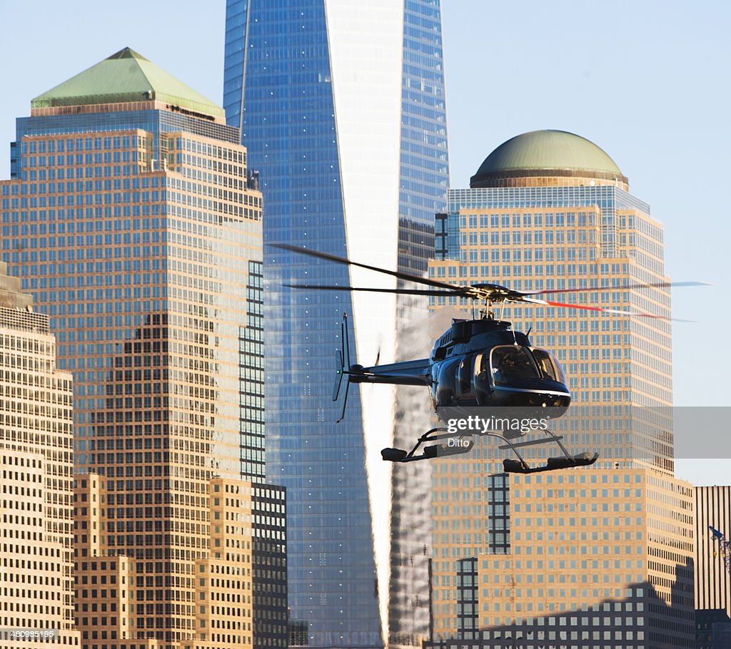 Close up of helicopter and office buildings, New York, USA