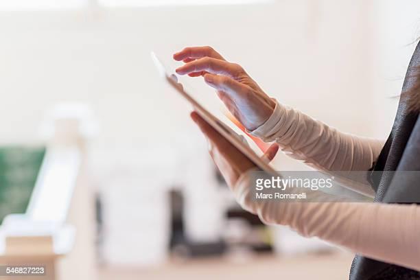 Close up of Hispanic businesswoman using digital tablet