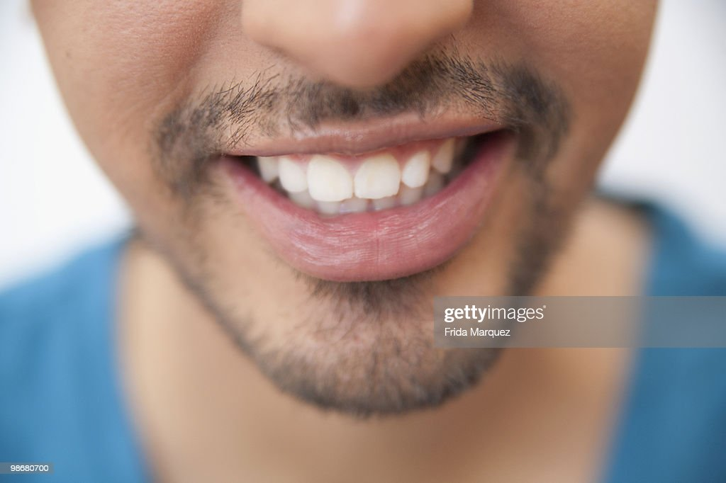 Close up of Hispanic man's mouth and goatee : Stock Photo