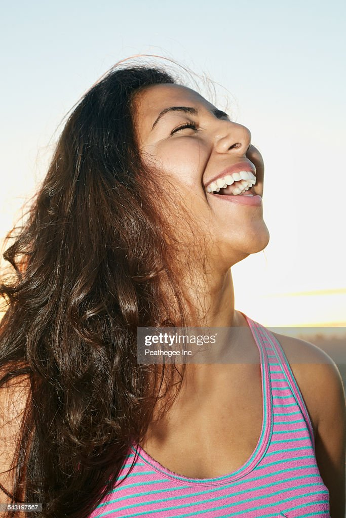 Close up of Hispanic woman laughing