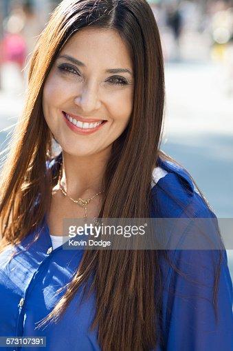 Close up of Hispanic woman smiling outdoors