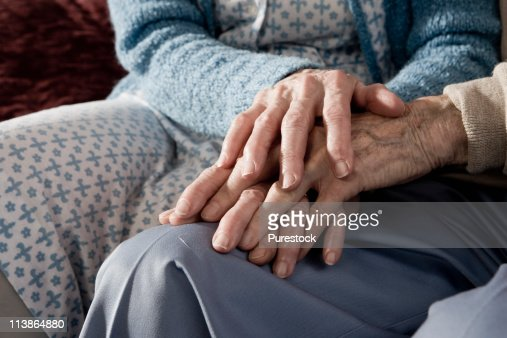 Close up of holding hands of senior couple : Stock Photo