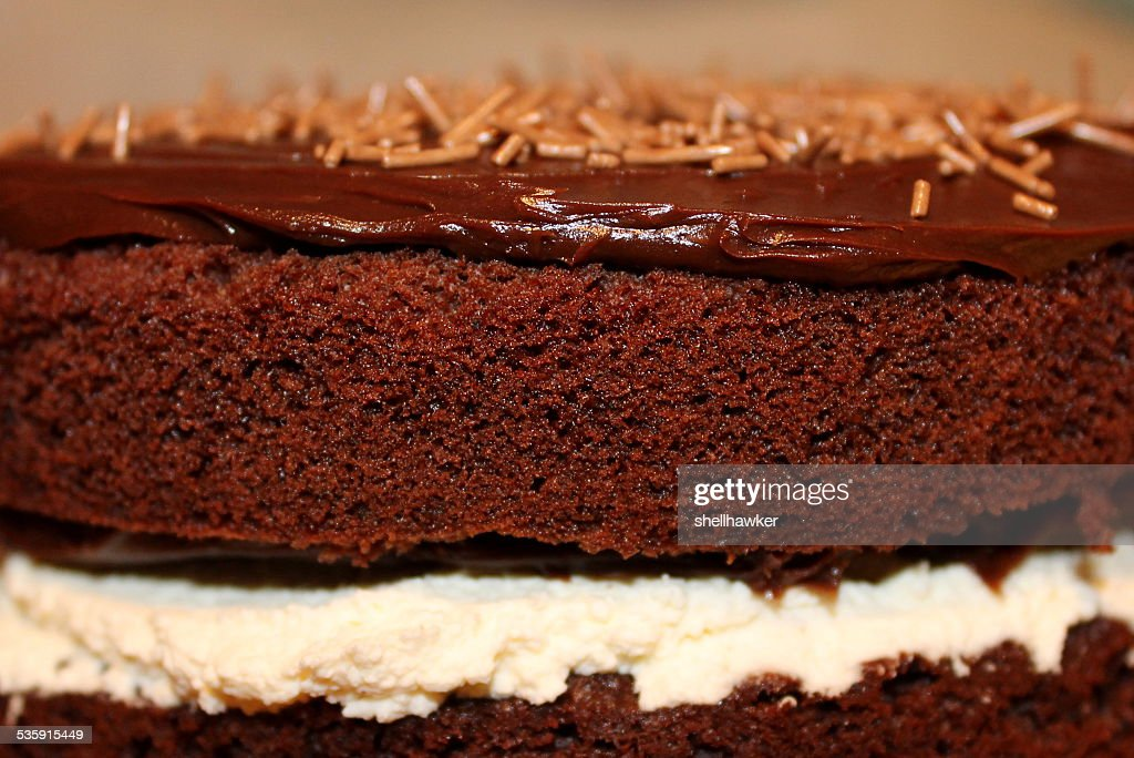 Close up of Homemade Chocolate Cake with cream and ganache : Stock Photo