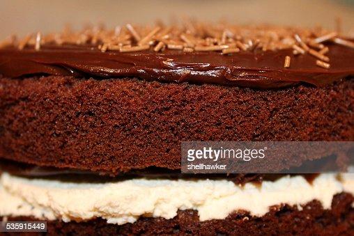 Close up of Homemade Chocolate Cake with cream and ganache : Stock Photo