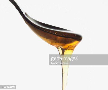 Close up of honey dripping from spoon