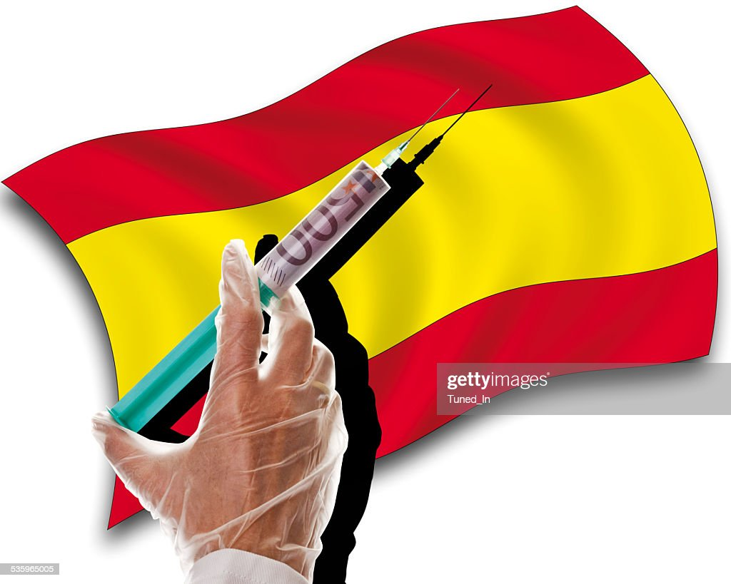 Close up of human hand with cash injection, spanish flag : Stock Photo