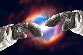 Close up of human hands touching with fingers in space. Elements of this image furnished by NASA