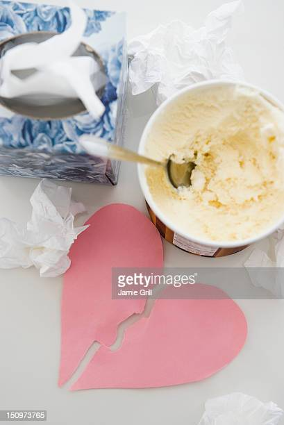 Close up of ice creams and broken paper heart