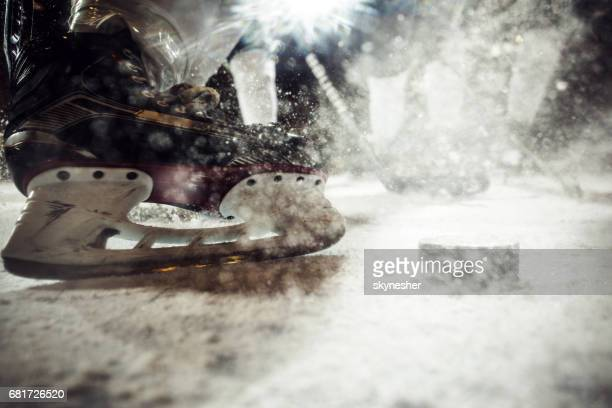 Close up of ice hockey player's skate on ice.