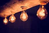 Close up of illuminated light bulbs at night