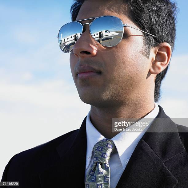 Close up of Indian businessman with mirrored sunglasses