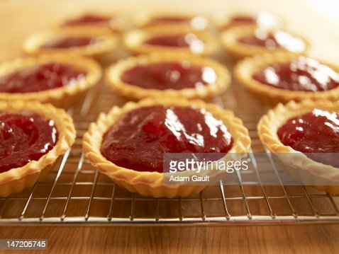 Close up of jam tarts cooling on wire rack : Stock Photo