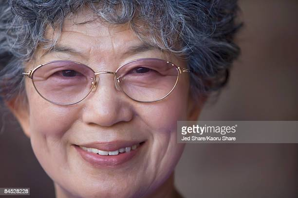 Close up of Japanese woman wearing eyeglasses