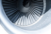 Close up of a contemporary turbofan aircraft engine. The photo shows a suction part of the jet engine and turbine blades.