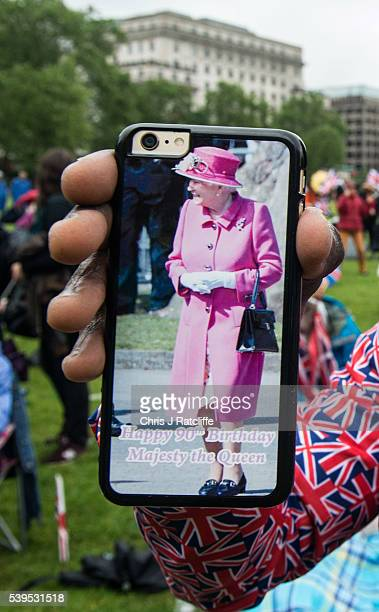 A close up of Joseph Afrane's Queen Elizabeth II birthday phone cover as members of the public gather in Green Park for a picnic and to watch The...
