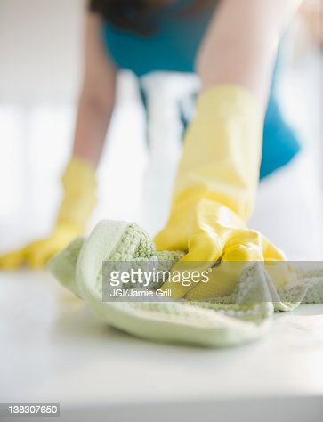 Close up of Korean woman wiping counter : Stock Photo