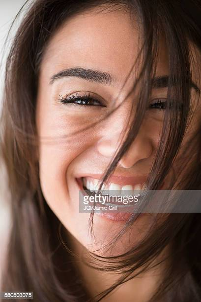 Close up of laughing woman with messy hair