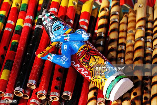 Close up of Lord Krishna figurine on flutes