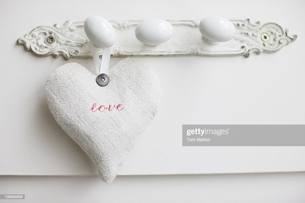 Close up of love heart hanging on hook : Stock Photo