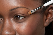 Close up of make up brush near eye