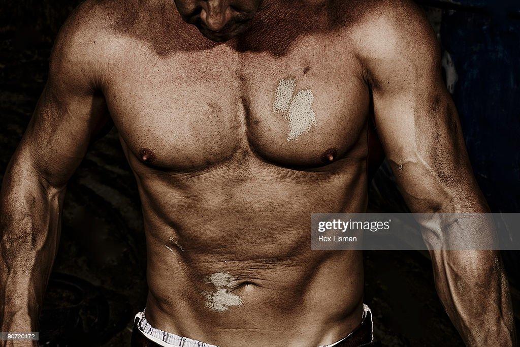 Close up of male bodybulider's torso : Stock Photo