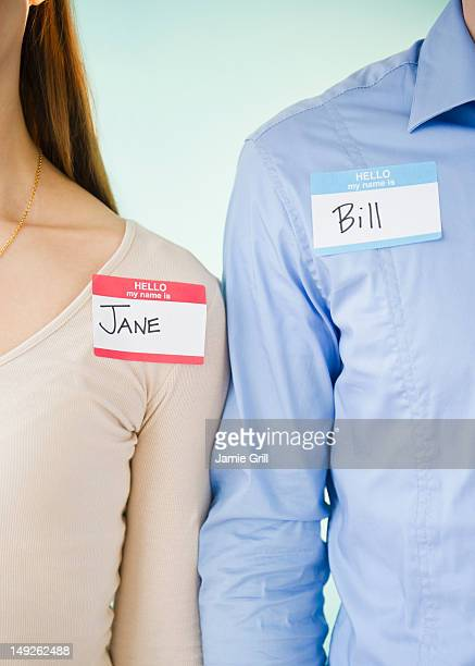 Close up of man and woman standing arm in arm, studio shot