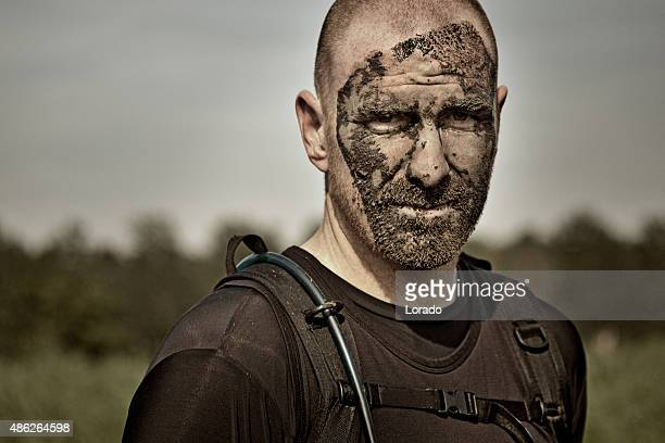 close up of man covered by mud