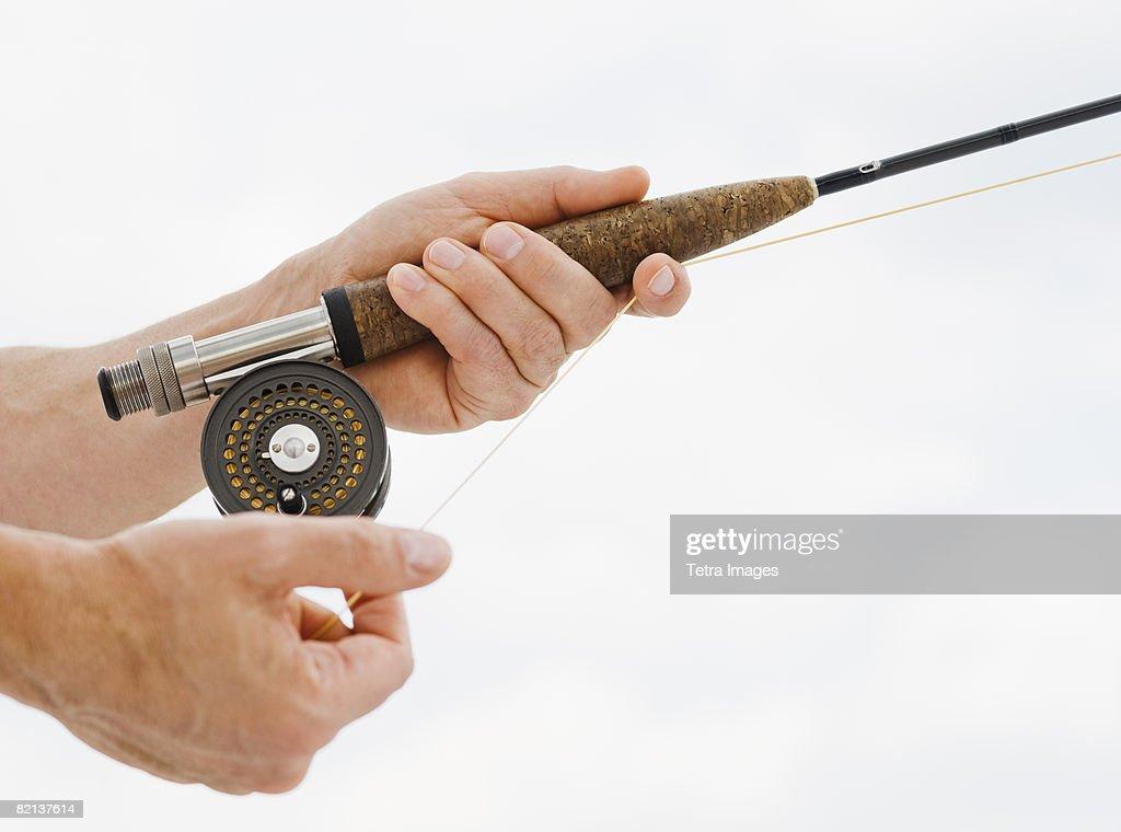 Close up of man fishing rod