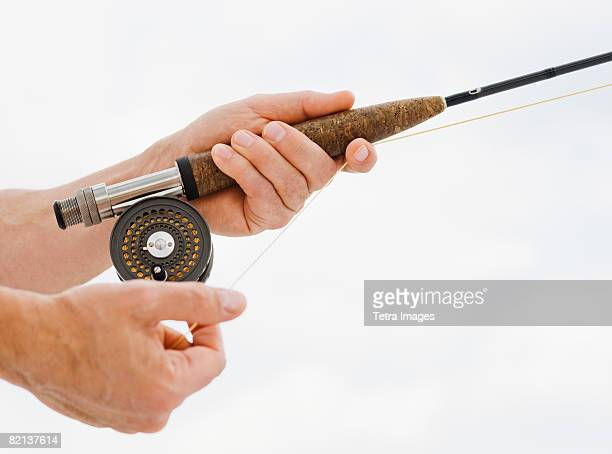 Close up of man fishing rod