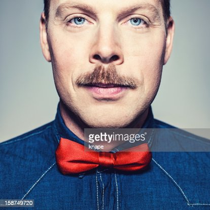 Close up of man in bow tie