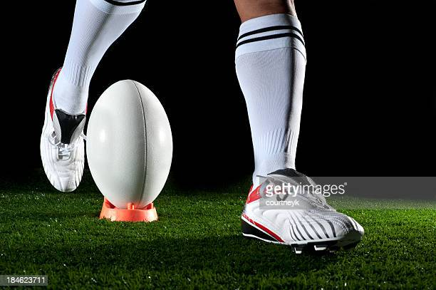Close up of man kicking a rugby goal