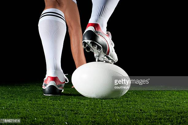 Close up of man playing a rugby ball