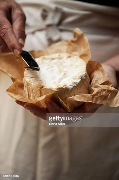 Close up of man slicing cheese