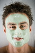 Close up of man smiling with spa facial treatment