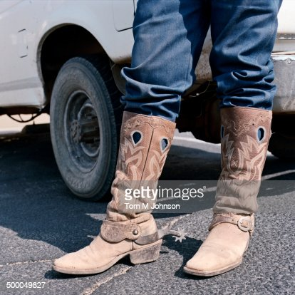 Close Up Of Man Wearing Cowboy Boots With Spurs Stock Photo ...