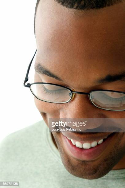 Close up of man wearing glasses looking down