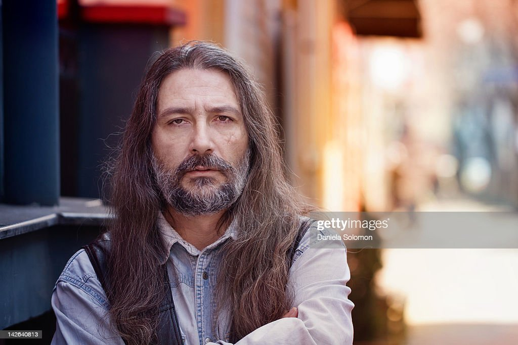 Close up of man with long hair and beard : Stock Photo
