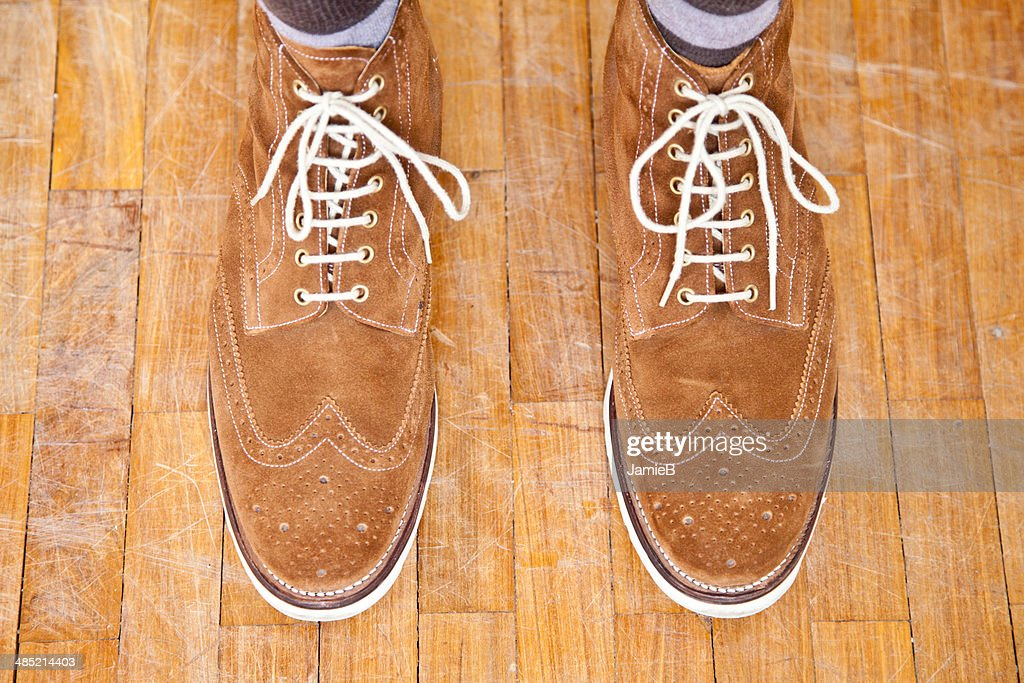 Close up of mans feet wearing suede boots