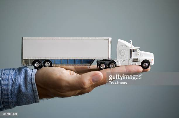 Close up of man's hand holding toy truck