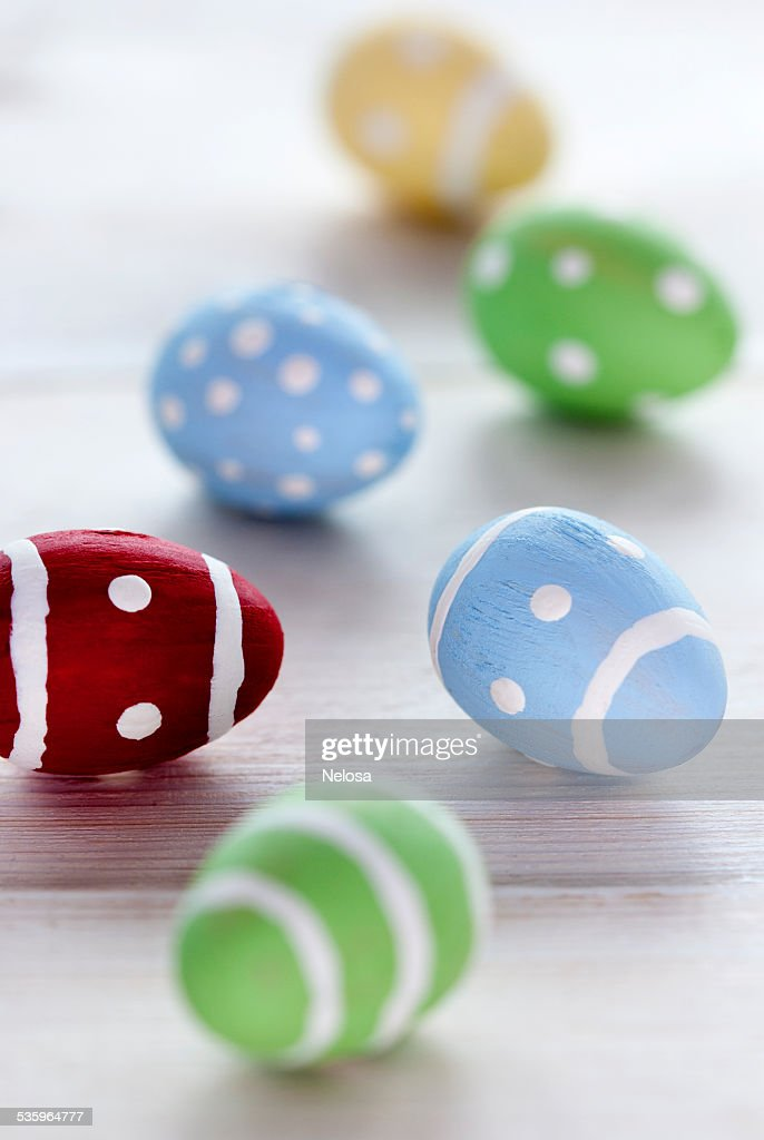 Close Up Of Many Colorful Easter Eggs On Wooden Background : Stock Photo