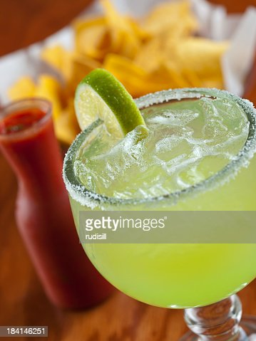 Close up of margarita with chips and salsa