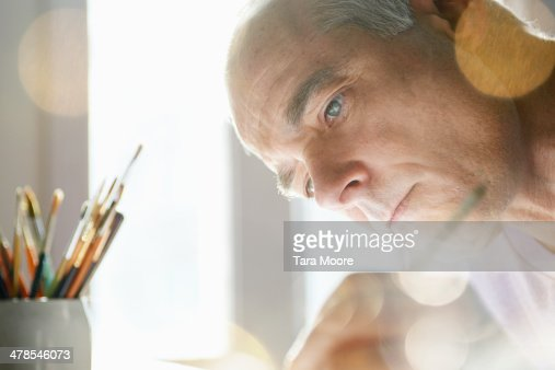 close up of mature man painting