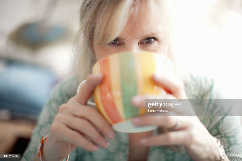 Close up of mature woman drinking coffee : Stock Photo
