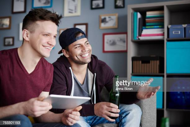 Close up of men with digital tablet and drink. Debica, Poland