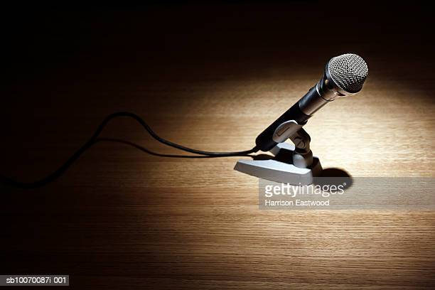 Close up of microphone on table spotlight