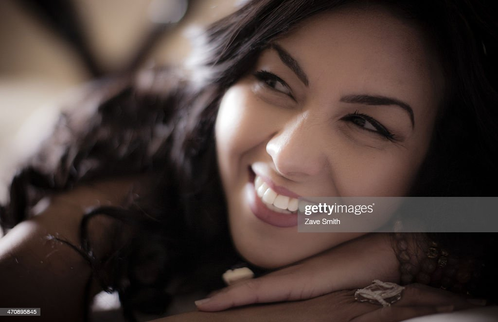 Close up of mid adult woman lying on bed : Stock Photo