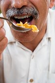Close up of middle-aged man eating