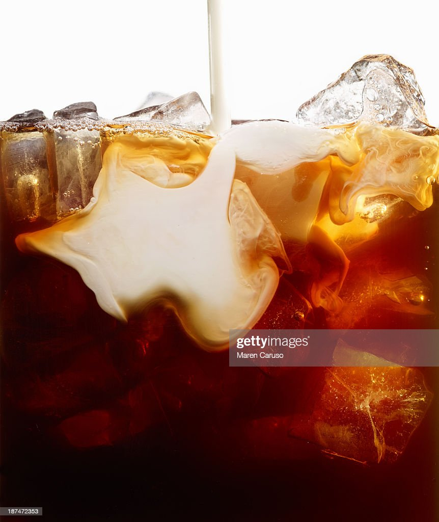 Close Up of Milk Pour into Iced Coffee