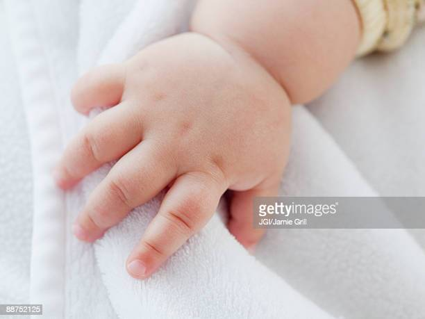 Close up of mixed race baby girl's hand