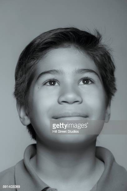 Close up of mixed race boy looking up